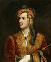 Half-length portrait of pale man in his mid twenties, sitting in red coat with gold trim. His left hand is holding an obscured tubular object that is pressed against his body. His dark brown hair is wrapped in an orange and red bandana, and he has a thin moustache.