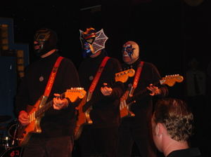 Los Straitjackets - Los Straitjackets performing in Las Vegas, Nevada in 2005.