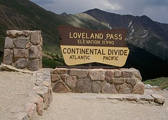 Grizzly Peak (Summit County, Colorado) - The Loveland Pass sign, with the mountain's peak visible behind it at center