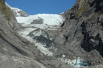 Franz Josef Glacier - Terminal face of Franz Josef Glacier viewed from lookout at end of valley walk as of 2014