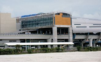 Miami Airport Station - The Metrorail station under construction in June 2011. The old Tri-Rail station, not yet closed, is at bottom left.