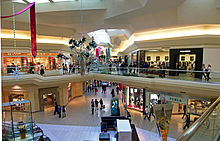 Picture of a modern shopping mall with two stories.