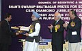 Manmohan Singh giving away the Shanti Swarup Bhatnagar Prize for Science and Technology 2008 to Dr. Ravinder Goswami of New Delhi for his outstanding contribution in Medical Sciences, in New Delhi on December 20, 2008.jpg