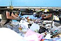 Marines at Camp Pendleton's Recycling Center sort the daily 5-ton load of trash on a conveyor belt to separate non-contaminated reusable products.jpg