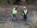 Men driving a pipe into the soil with a lump hammer.jpg
