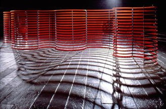 "Merle Temkin - Merle Temkin, Detail of Backfire, CUNY Mall, NYC; plexi-mirror strips, fluorescent paint, galvanized steel; 6' x 32"" x 5', 1984"