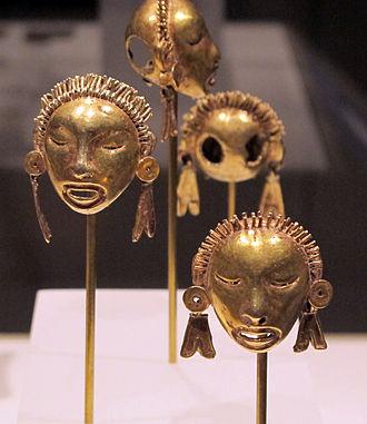 Metallurgy in pre-Columbian Mesoamerica - Gold pendants in the shape of heads, Mixtec or Aztec, c. 1400–1515, Metropolitan Museum of Art.