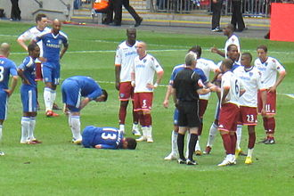 Michael Ballack - Ballack on the ground with the ankle injury in the 2010 FA Cup Final that eventually ruled him out of the World Cup after a tackle from Boateng (23).