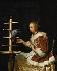 Woman feeding a Parrot