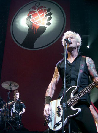 Green Day - Tré Cool (bottom left) and Mike Dirnt (right) performing on July 27, 2005.