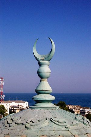 Alem (finial) - Crescent-topped alem on a minaret roof in Constanta