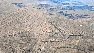 Drainage divide - A minor drainage divide south of Buckeye, Arizona.  Both branches flow to the Gila River.