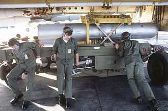 B28 nuclear bomb - B28FI being unloaded from a Boeing B-52H in 1984. The 3 ground crew show the size of this weapon