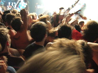 Moshing - Audience members moshing in front of the stage at a concert