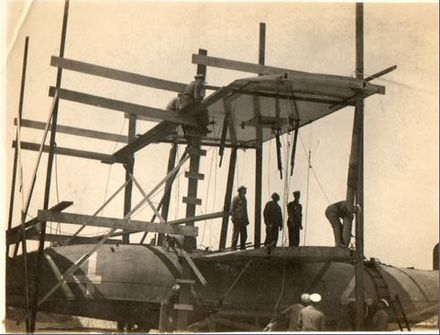 The NC-4 being dismantled in June 1919 at Plymouth, England, before being shipped back to United States NC-4 Dismantling landscape.jpg