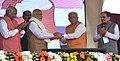 Narendra Modi shaking hands with the Chief Minister of Haryana, Shri Manohar Lal Khattar, at the Foundation Stone laying ceremony of NHAI Projects in Sonipat, Haryana. The Governor of Punjab and Haryana and Administrator.jpg