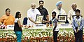 "Narendra Modi with the winners of Swachhata Hi Sewa themed painting competition, at an event to mark the Swachh Bharat Diwas the 3rd anniversary of the launch of Swachh Bharat Mission and the conclusion of ""Swachhata hi.jpg"
