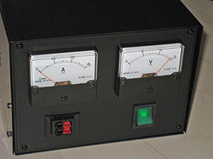 Power supply - A simple general purpose desktop power supply used in electronic labs, with power output connector seen at lower-left and power input connector (not shown) located at the rear