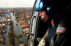 A U.S. Coast Guard aircrew searches for survivors in New Orleans during the aftermath of Hurricane Katrina.