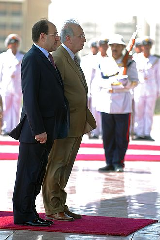 Nouri al-Maliki - The celebration ceremony of Iraq's national sovereignty was attended by Iraq's Prime Minister, Nouri al-Maliki, left, and the Minister of Defense, Abd al-Qadir, right, Baghdad, 30 June 2009.