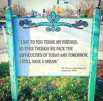 Oak Park, Sacramento, California - A permanent sign at the southeast corner of Martin Luther King Jr. Blvd. and 14th Ave. displaying a famous quote from Martin Luther King Jr.'s I Have a Dream speech