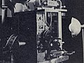 Optical printer by Carl Louis Gregory, close view with reflector, paper print frame in aperture of projector head, several covers removed for display, March 1943.jpg