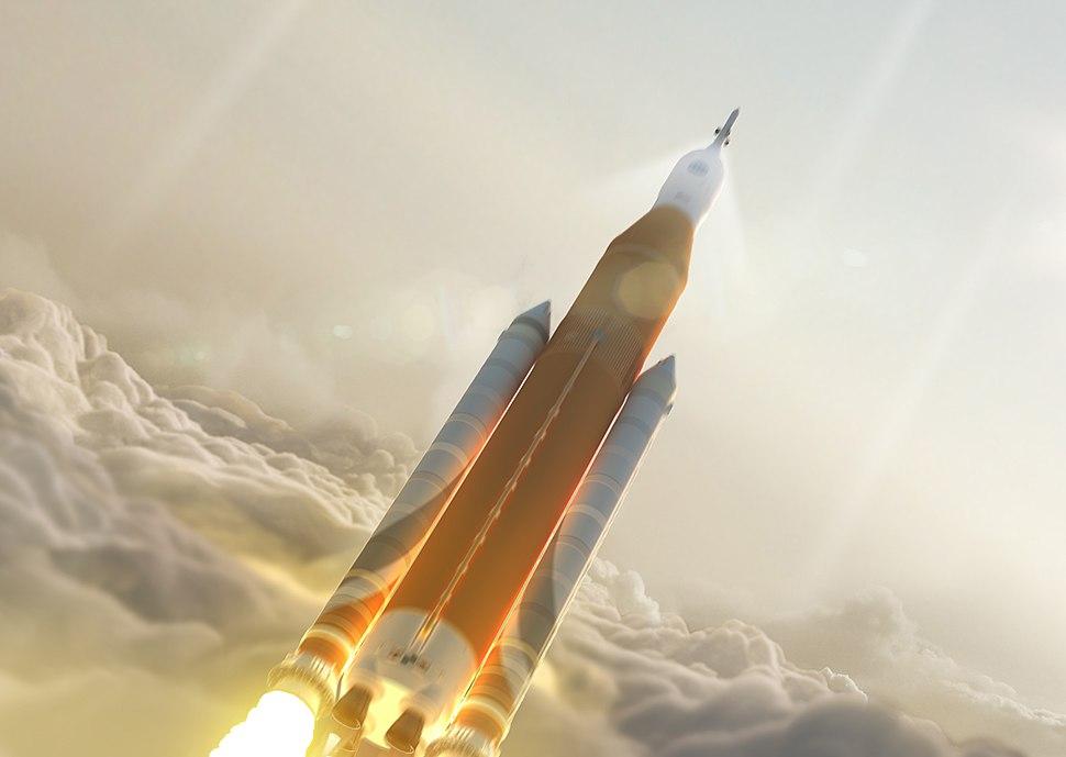 Orange tank SLS launch through clouds - Post CDR