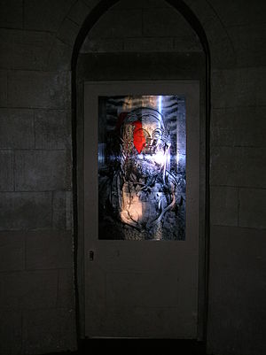 Ossian's Hall of Mirrors - An image of Ossian on an internal door in the hall of mirrors.