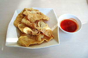 Wonton - Pangsit Goreng (fried wonton) with sweet and sour sauce of Indonesian Chinese cuisine