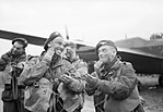 Paratroops of 6th Airborne Division blackening their faces in front of an Albemarle aircraft at RAF Harwell, 5 June 1944. H39066.jpg