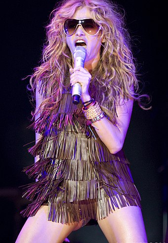 "Mexican singer Paulina Rubio has been referred to as the ""Queen of Latin Pop"" and ""Madonna Latina"". Paulina Rubio @ Asics Music Festival 10.jpg"