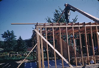 Domestic roof construction - A roof being framed in the United States circa 1955