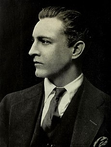 Head and shoulder shot of Barrymore, cleanshaven, in profile, facing to the left
