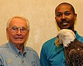 Posing for picture with Bald Eagle. (10594423515).jpg