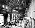 Powerhouse interior showing placement of water wheel for generating unit no 3 using 50-ton crane, June 8, 1904 (SPWS 505).jpg
