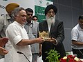Prakash Singh Badal presenting a memento to the Minister of State for Environment and Forests (Independent Charge), Shri Jairam Ramesh, at 6th National Meeting of State Biodiversity Boards, in Chandigarh.jpg
