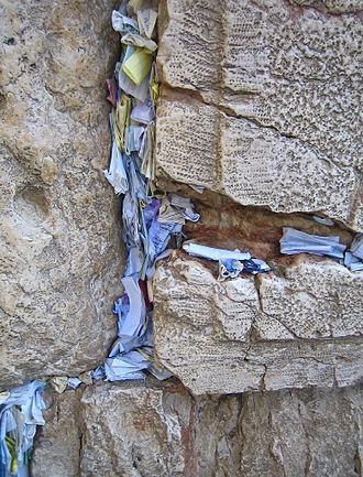 Placing notes in the Western Wall - Notes wedged into the cracks of the Western Wall.
