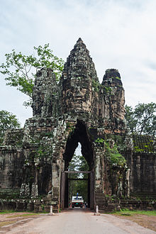 Khmer architecture wikipedia many of the gopuras constructed under jayavarman vii toward the end of the 12th century such as this one at angkor thom are adorned with gigantic stone malvernweather Choice Image