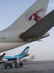 Old livery of Qatar Airways, the blue plane is in special colours for the 15th Asian Games 2006 in Doha