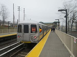 R44 train at Arthur Kill on the second day of the station's operation.jpg