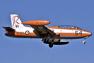 Side view of two-seat, single-engined military jet in flight, wheels down