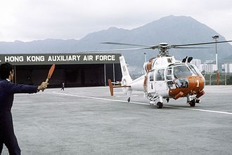 British Forces Overseas Hong Kong - A Royal Hong Kong Auxiliary Air Force Aerospatiale Dauphin helicopter leaving its hangar during a Search and Rescue exercise in 1982.