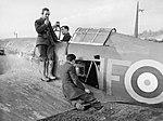 Radio mechanics testing the VHF transmitter-receiver in a Hawker Hurricane Mk I of No. 601 Squadron RAF at Exeter, Devon, November 1940. CH1636.jpg