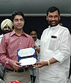 Ram Vilas Paswan presenting a cheque of Rs. 15 lakh to the first winner of an individual Gold Medal for India at the Beijing Olympic Games and International Shooting Ace, Shri Abhinav Bindra in New Delhi.jpg