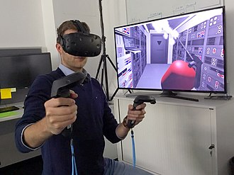 Virtual reality - Researchers with the European Space Agency in Darmstadt, Germany, equipped with a HTC Vive head-mounted VR headset and motion controllers, demonstrates how astronauts might use virtual reality in the future to train to extinguish a fire inside a lunar habitat