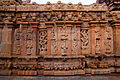 Relief sculptures and window art on rear wall of Bhoganandishwara Temple.jpg