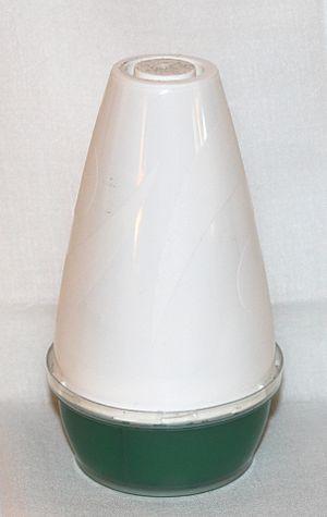English: Renuzit air freshener dispenser.