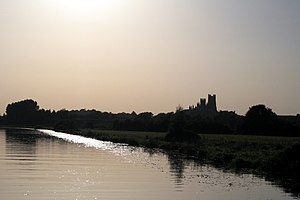 Siward Barn - Ely cathedral with the River Great Ouse in the foreground; though most of the Fenland was drained in the early modern period and Ely is no longer an island, the landscape retains some watery features