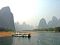 River boat on the side of the Li River.jpg