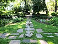 Roger Morris Park garden with sundial.jpg